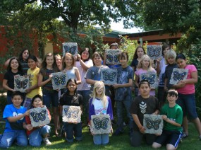 Students with new butterfly stepping stones they created for the Butterfly Garden.