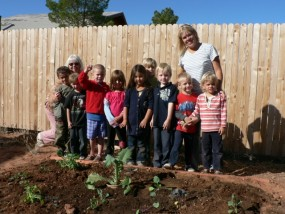 Kids tend their plants in the schoolyard.